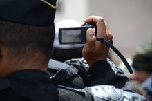 A Gendarme Films The Demonstrators During A Demonstration