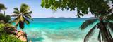 Fototapeta Fototapety z morzem do Twojej sypialni - Palm and tropical sea beach panorama. Anse Source d'Argent, La Digue island. Seychelles