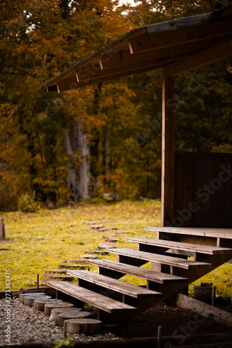 Wooden staircase to the veranda in autumn Canvas Print