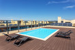 canvas print picture - Modern pool for tourists on the roof of the building.