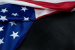 American flag on black wooden board. Top view with copy space.