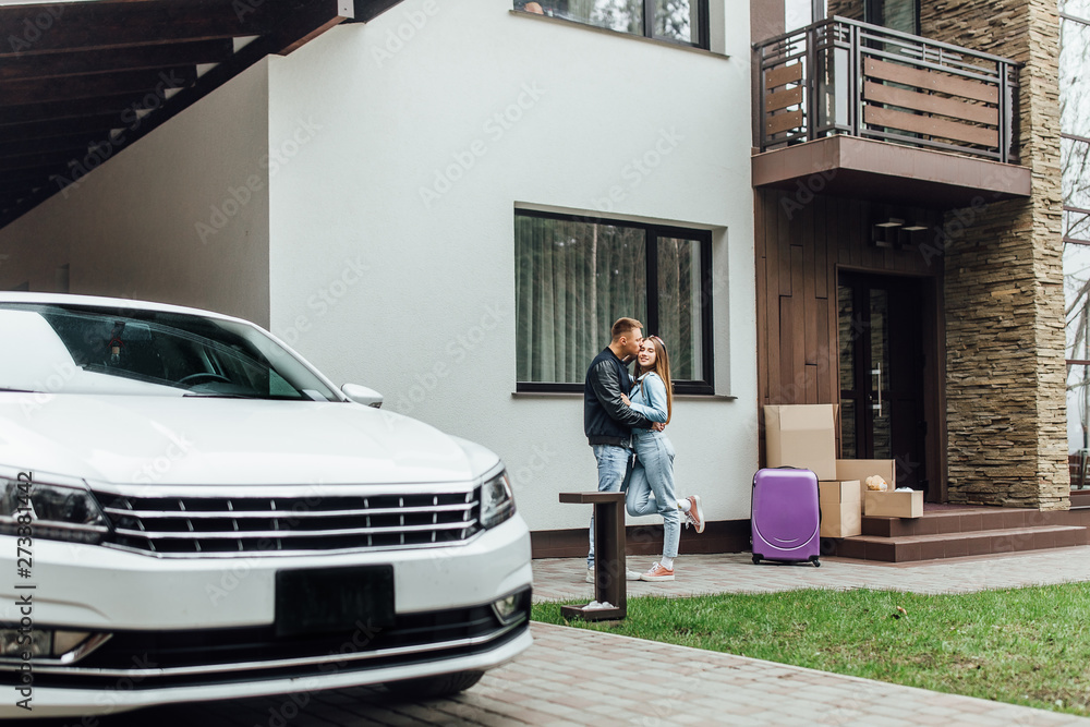 Fototapety, obrazy: Smiling couple hugging near their modern villa.. Moving time..