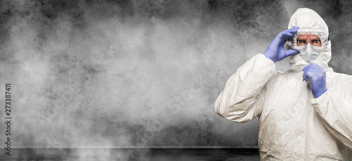 Fototapeta  Man Wearing Hazmat Suit and Goggles In Smokey Room Banner with Copy Space