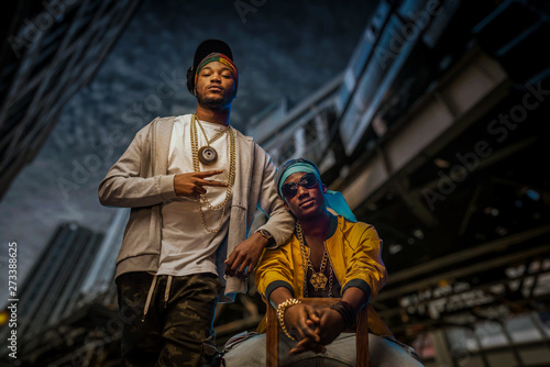 Fotografie, Obraz Two black rappers poses on night city street