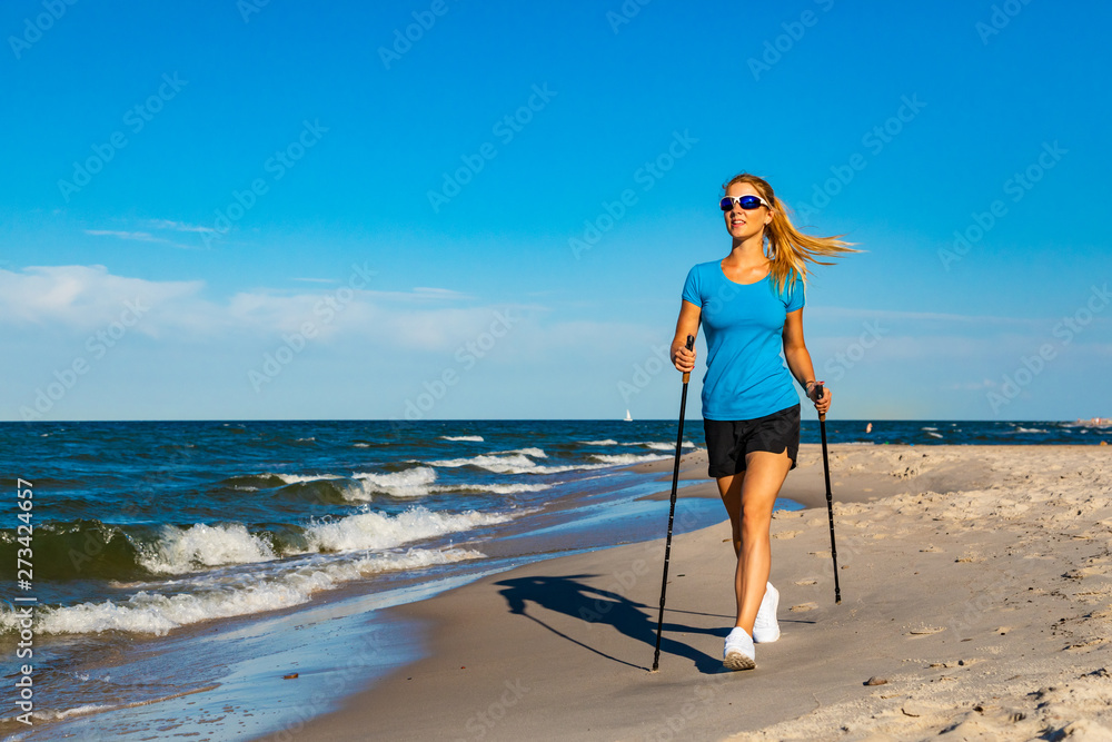 Fototapety, obrazy: Nordic walking - young woman training