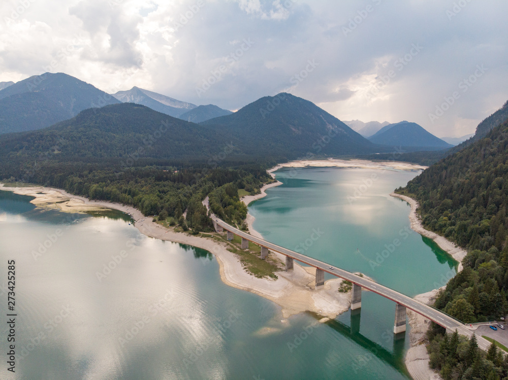 Germany, August 2018: Amazing turquoise lake Sylvenstein, upper Bavaria. Aerial view.