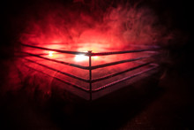 Empty Boxing Ring With Red Rop...