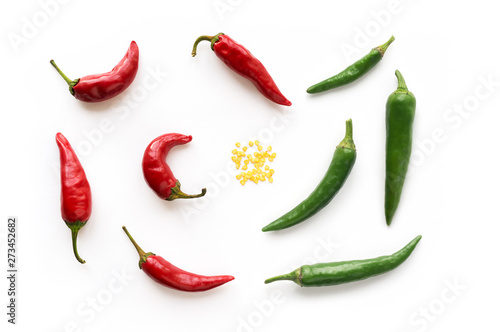 Cadres-photo bureau Hot chili Peppers Red and Green hot chilli peppers with seed. Food background. Top view.