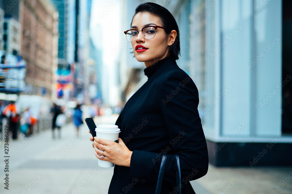 Fototapety, obrazy: Half length portrait of confident proud ceo expert dressed in elegant apparel looking at camera while standing on Manhattan street during work break for coffee, attractive businesswoman outdoors