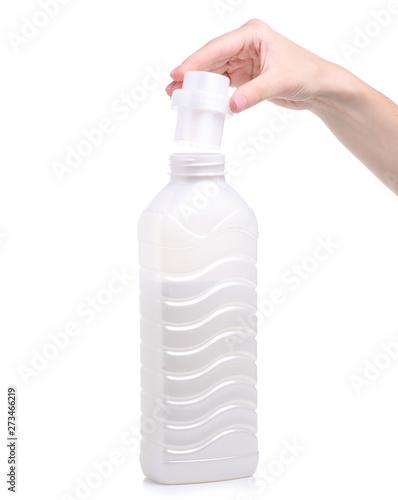 Softener Conditioner In White Plastic Bottle In Hand
