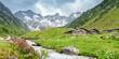 canvas print picture - Panorama von Almhütten mit Gletscher im Hintergrund