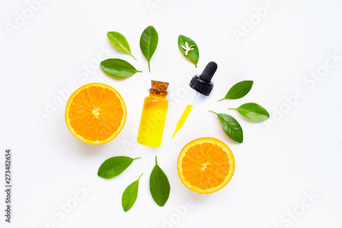 Obraz na plátně  Essential oil with fresh orange citrus fruit on white