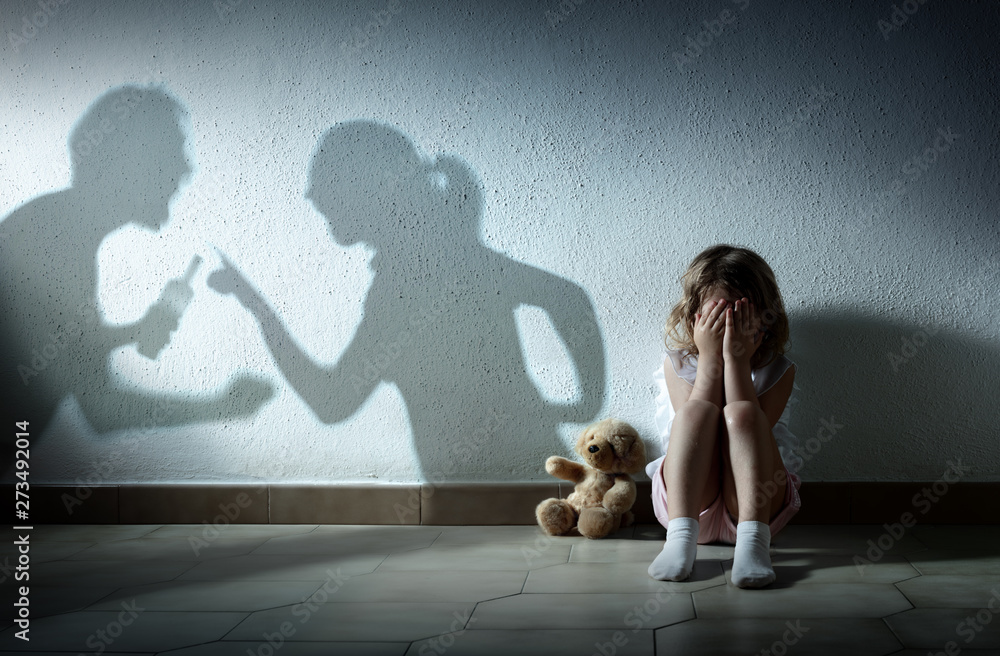Fototapety, obrazy: Little Girl Crying With Shadow Of Parents Arguing - Home Violence And Divorce