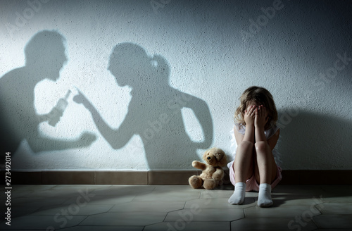Little Girl Crying With Shadow Of Parents Arguing - Home Violence And Divorce Canvas Print