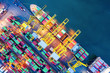 canvas print picture - Container cargo ship in import export business logistic at night