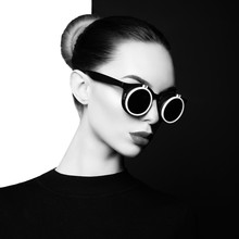 Beautiful Young Woman With Black Sunglasses