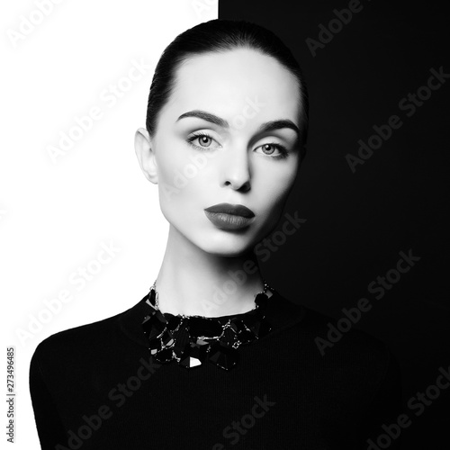 Poster womenART beautiful young woman with black bijouterie pose in studio