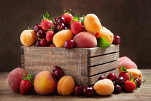 Fresh Ripe Fruits In A Wooden Box