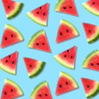 Leinwandbild Motiv Colorful summer fruit pattern of watermelon slices on a pastel blue background