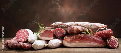 Fototapeta Various kind types of salami, speck and sausages obraz