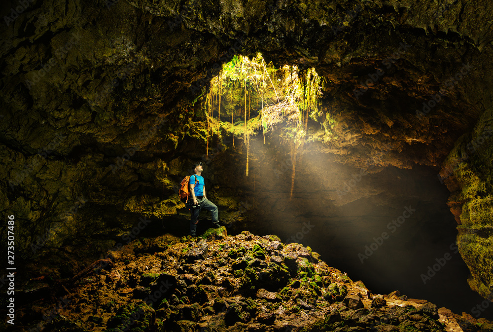 Fototapety, obrazy: Cave in the Azores with backpacker