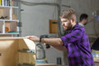 furniture factory, Small-Sized Companies and people concept - Young worker works in a factory for the production of furniture