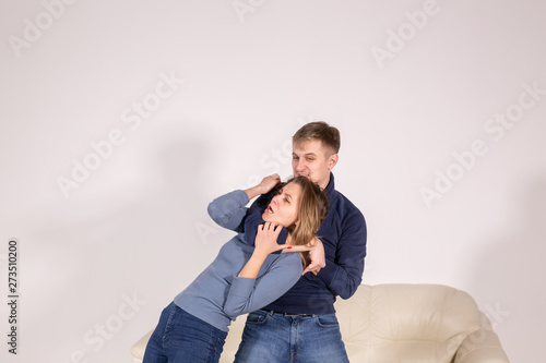 Obraz na plátně people, abuse and violence concept - agressive man strangling his wife
