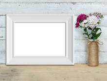 Horizontal A4 Vintage White Wooden Frame Mockup Near A Bouquet Of Sweet-william  Stands On A Wooden Table On A Painted White Wooden Background. Rustic Style, Simple Beauty. 3d Render.