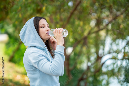 Fototapeta Thirsty woman drinking water after sport activities.Health concept. obraz na płótnie