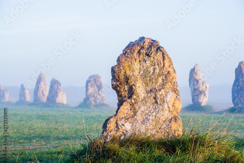 Menhir alignment view at Camaret sur mer at sunrise during fog Canvas