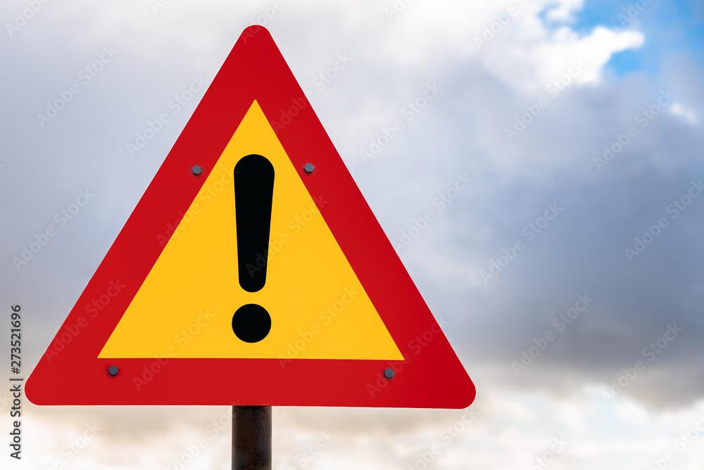 Fototapeta Hazard ahead warning road sign against cloudy sky in Iceland