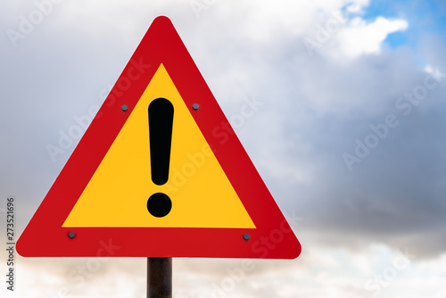 Fotomural Hazard ahead warning road sign against cloudy sky in Iceland