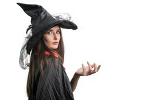 Happy Gothic Young Woman In Witch Halloween Costume With Hat Standing Over White Background