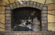 canvas print picture - Concrete dirty fireplace with remains of ash after wooden firewood burnt in fireplace