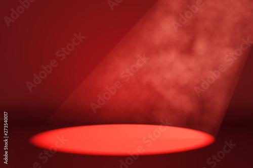 Fotografiet  Spot light on red background