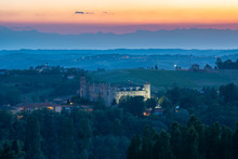 Castle Of Costigliole D'Asti (Piedmont - Italy). Sunset Light View With White Castle Bright
