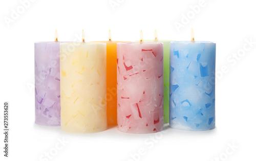 Obraz Alight color wax candles on white background - fototapety do salonu