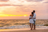 Fototapeta Fototapety z morzem do Twojej sypialni - Honeymoon couple walking on sunset romantic stroll on Lover's key beach in Florida enjoying evening light relaxing on tropical summer vacation travel holiday. Two adults silhouettes lifestyle.