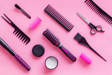 Professional Accessories Of Hairdresser With Combs And Sciccors On Work Desk Pink Background Top View Copyspace