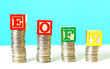 canvas print picture - End of Financial Year and savings concept stacking coins with EOFY building blocks.