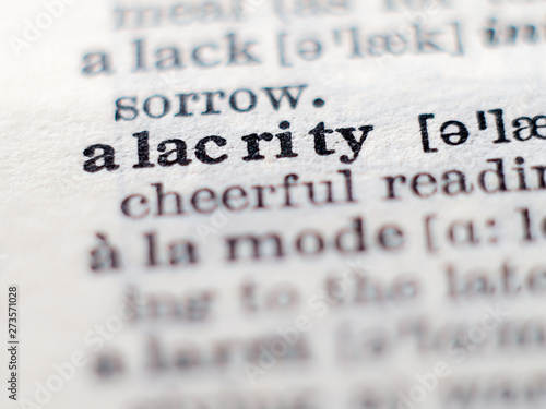 Photo Dictionary definition of word alacrity. Selective focus.
