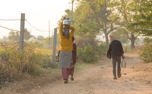 Rural Girl Carry Water
