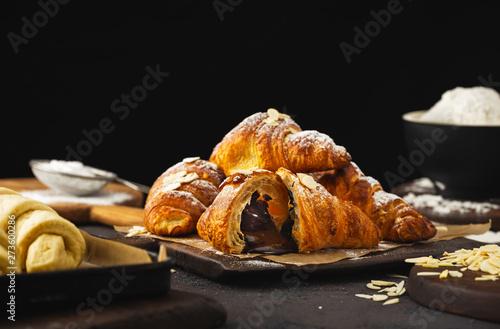 Carta da parati Freshly baked croissant with chocolate close up