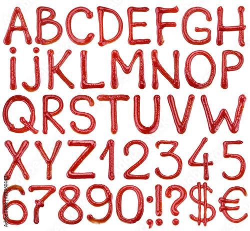 Fototapeta Letters of the alphabet written ketchup sauce. obraz
