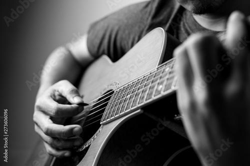 Fényképezés  Musicians are playing acoustic guitar.