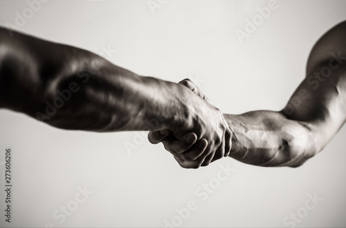 Fotografía  Two hands, isolated arm, helping hand of a friend