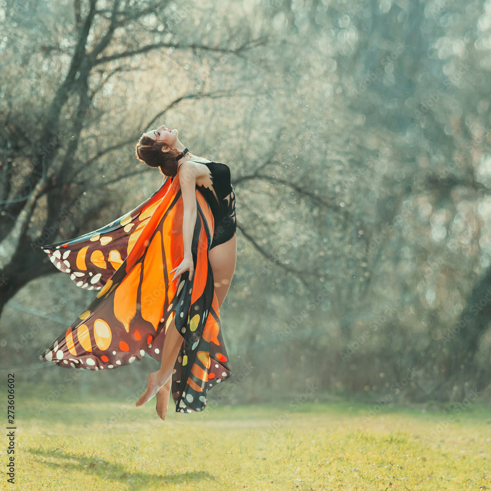 Fototapety, obrazy: attractive slender girl with braided dark hair in a black chic body and light bright butterfly wings flies up into the air, the joy of warm summer days, the first flight of moth, lightness and grace