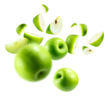 A Group Of Green Apples Levitating On A White Background