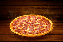 Pizza On Wooden Table. Flying Hot Pizza Pepperoni Closeup With Mozzarella Cheese And  Steam Smoke