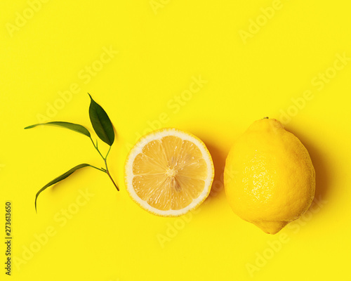 Fresh juicy lemon on a bright yellow background Poster Mural XXL